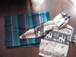 My very own alpaca products from Otavalo: a blanket ($11) and a sweater ($14).