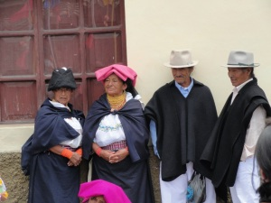 Women and men hanging out in Otavalo. Courtesy of google images.